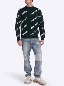Green and white logo sweater