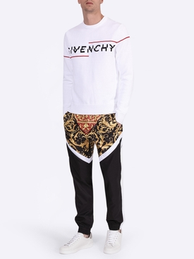Paneled baroque print track pants