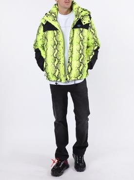 Neon yellow snake print puffer jacket