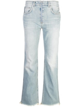 Flared distressed light blue jeans