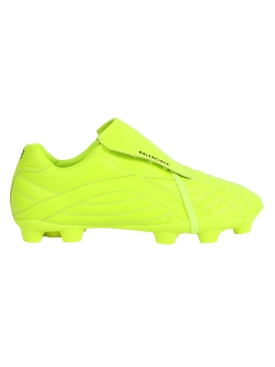 Fluorescent yellow soccer sneakers