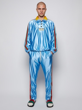 Shiny jersey jogging trousers with web