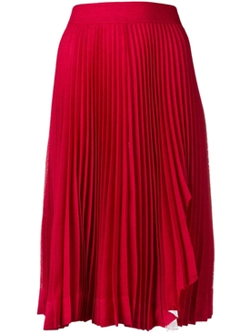 Red pleated shark bite midi skirt