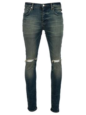Distressed denim jeans tinted indigo