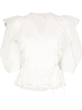White ruffled wrap-around top