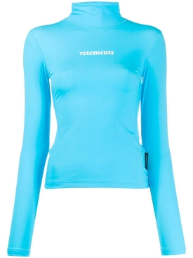 Turquoise turtleneck logo top