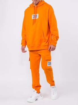 orange logo patch track pants