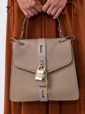 small beige aby handbag