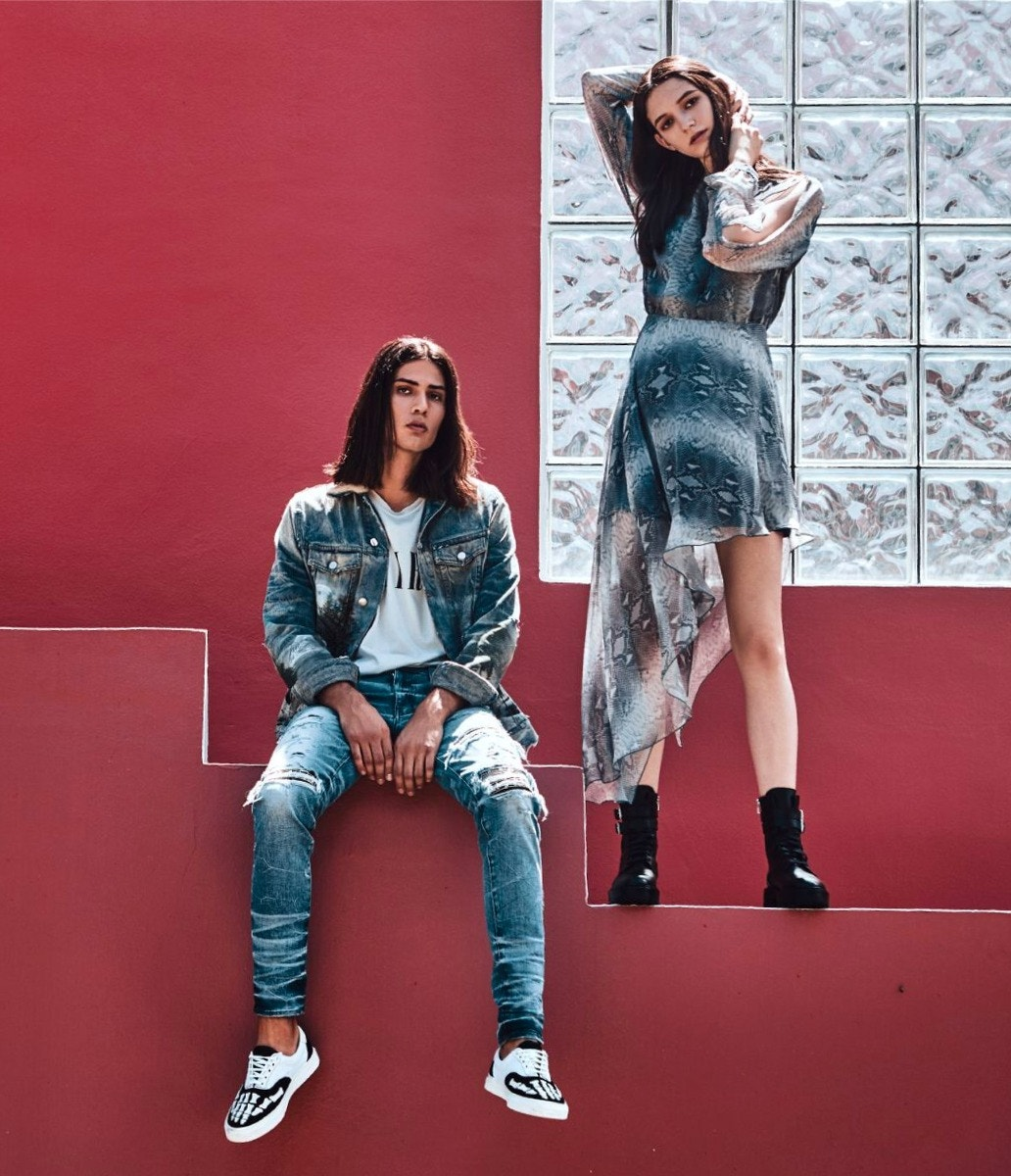 HIM: AMIRI Core Tee – Denim Jacket – Music Note Patch Jean – Skel Toe Slip On Sneaker, HER: AMIRI Python Print Dress – Combat Boots