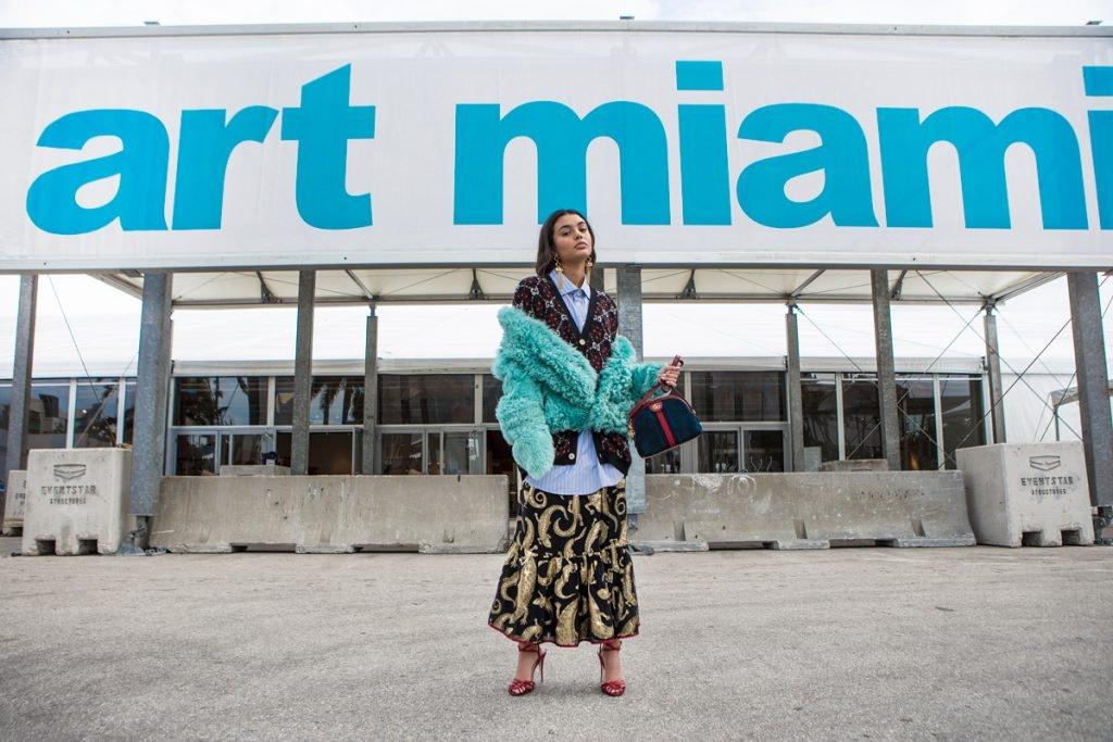 SIES MARJAN Double Breasted Coat, GUCCI GG Diamond Wool Cardigan, GUCCI Pinstripes Skirt, GUCCI Long Ruffled Skirt, GUCCI Sandals, ELLERY Barbosa Earrings. Location: Art Miami