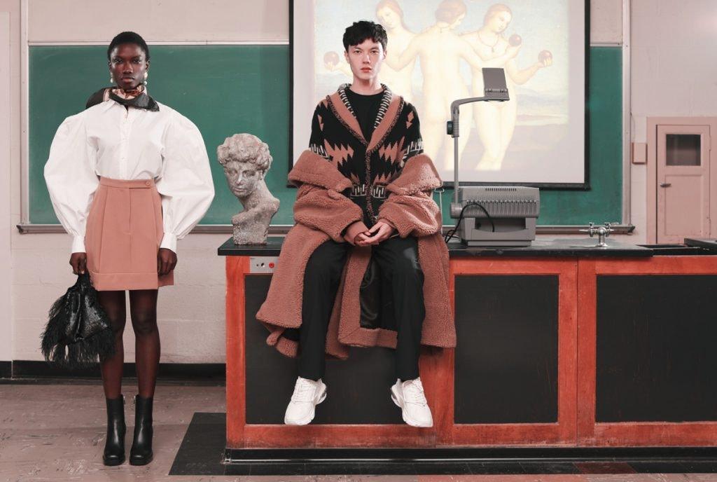 SARA BATTAGLIA Poplin Top, SARA BATTAGLIA Pleated Mini Skirt, ATTICO Bag, OFF-WHITE Oversized Camel Hair Coat, ALANUI Pattern Cardigan, OAMC Trousers, VALENTINO Garavani Spray-Painted Sneakers