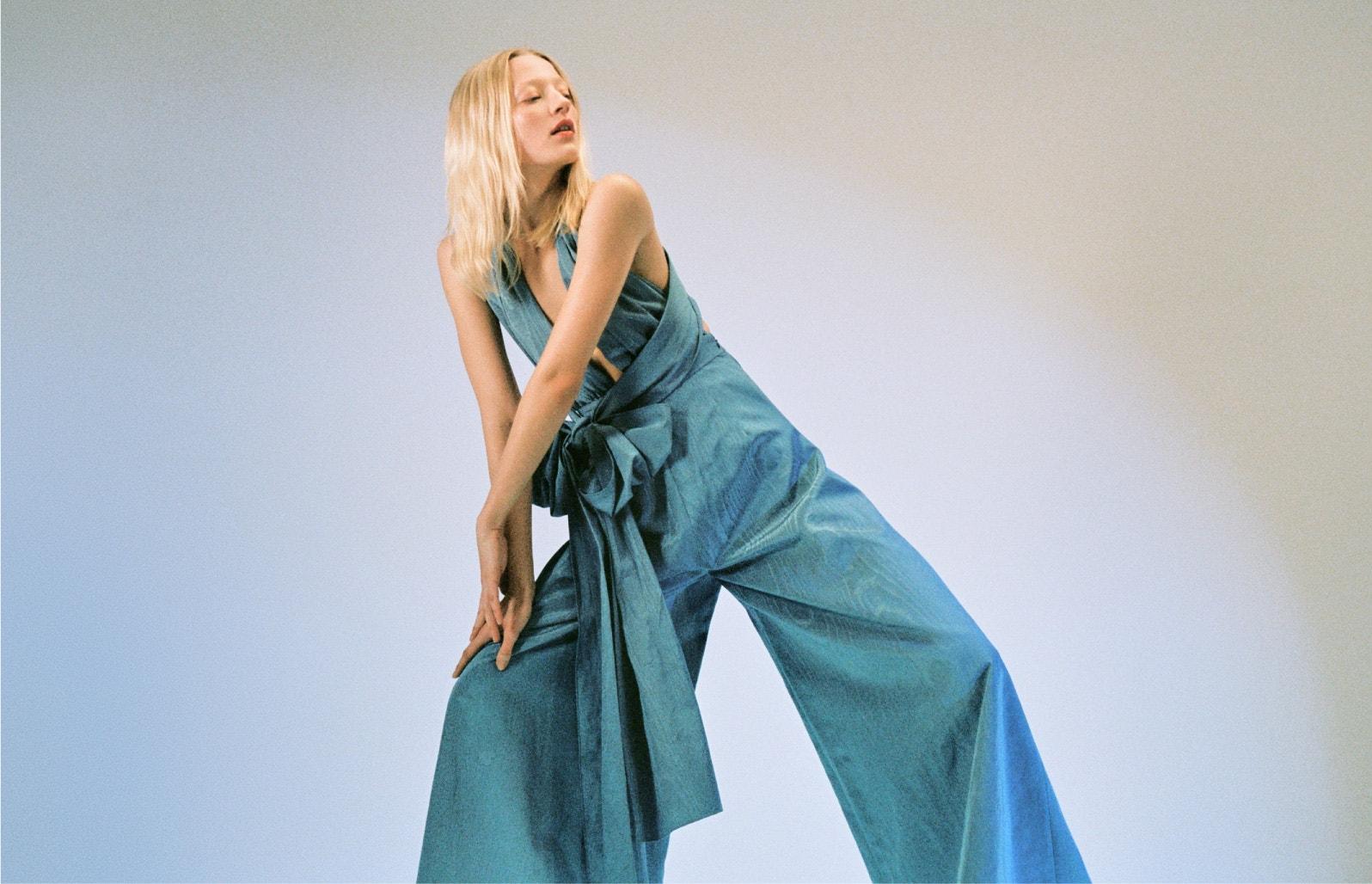 woman wearing blue oscar de la renta jumpsuit