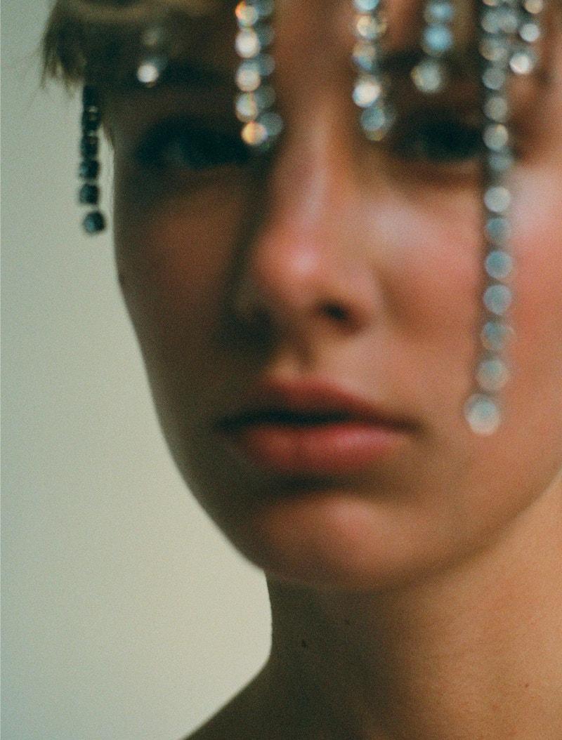 model wearing khaite jewels