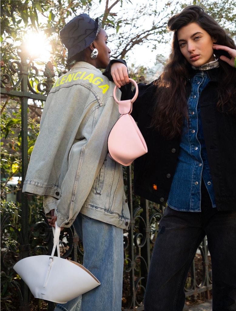 model wearing balenciaga denim jacket, alexander wang shirt, re/done jeans, emma charles bag, and fendi hair clip