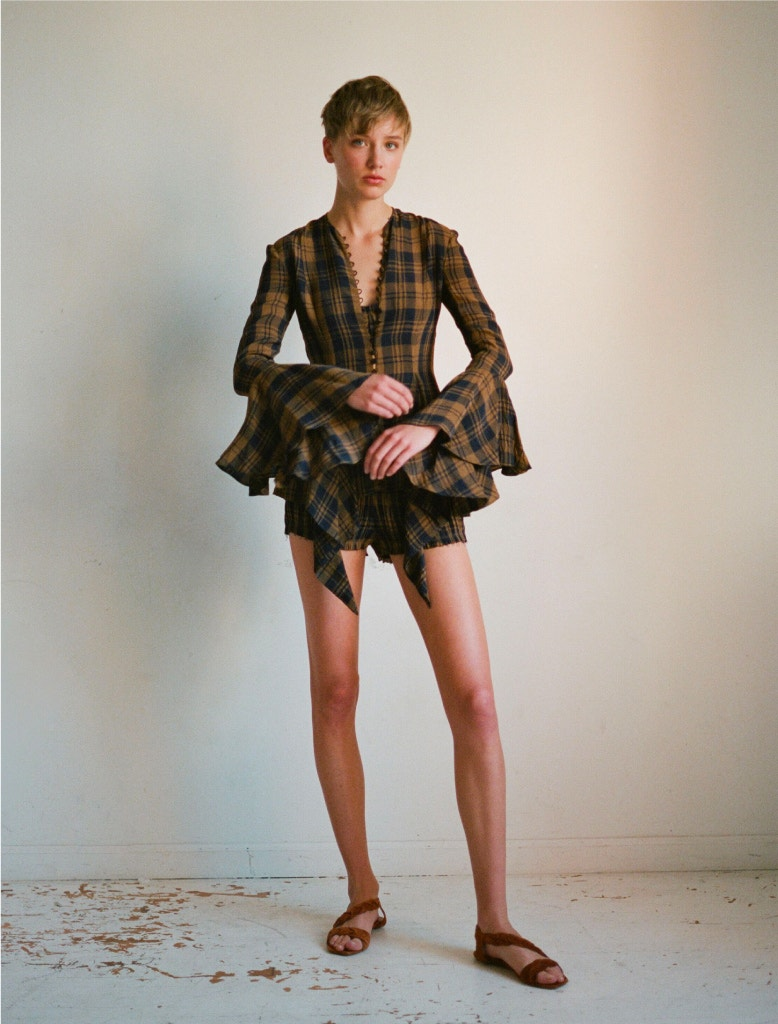 model wearing khaite elliot top, indira bra, hilary shorts