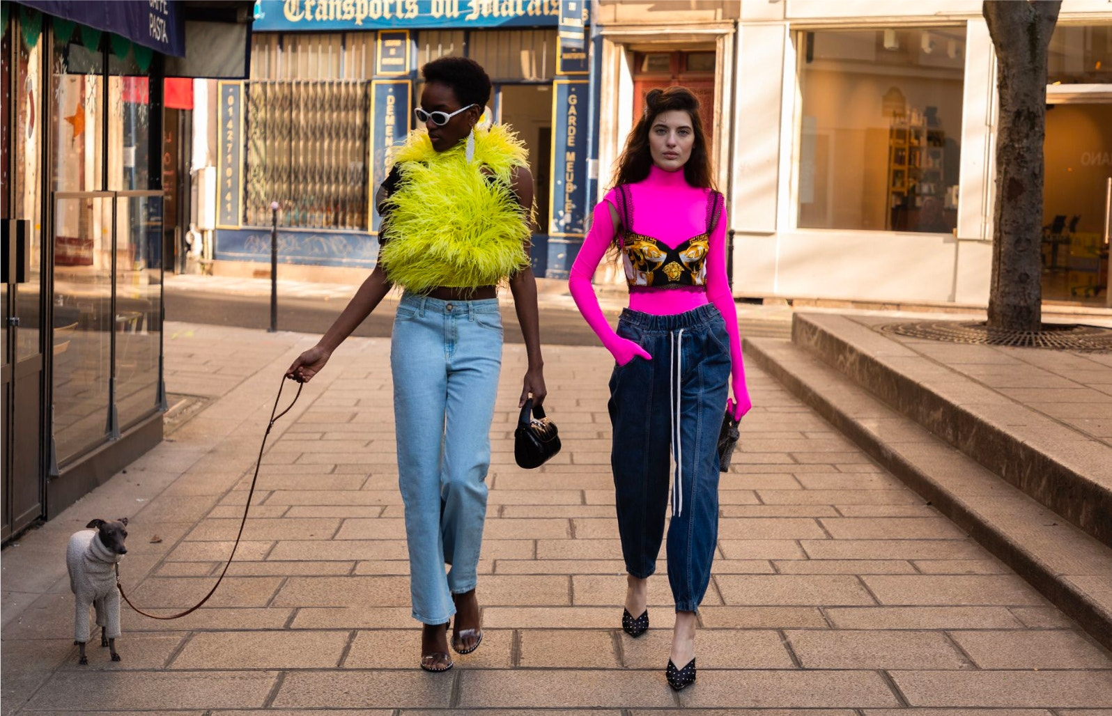 models wearing bold tops paired with relaxed denim
