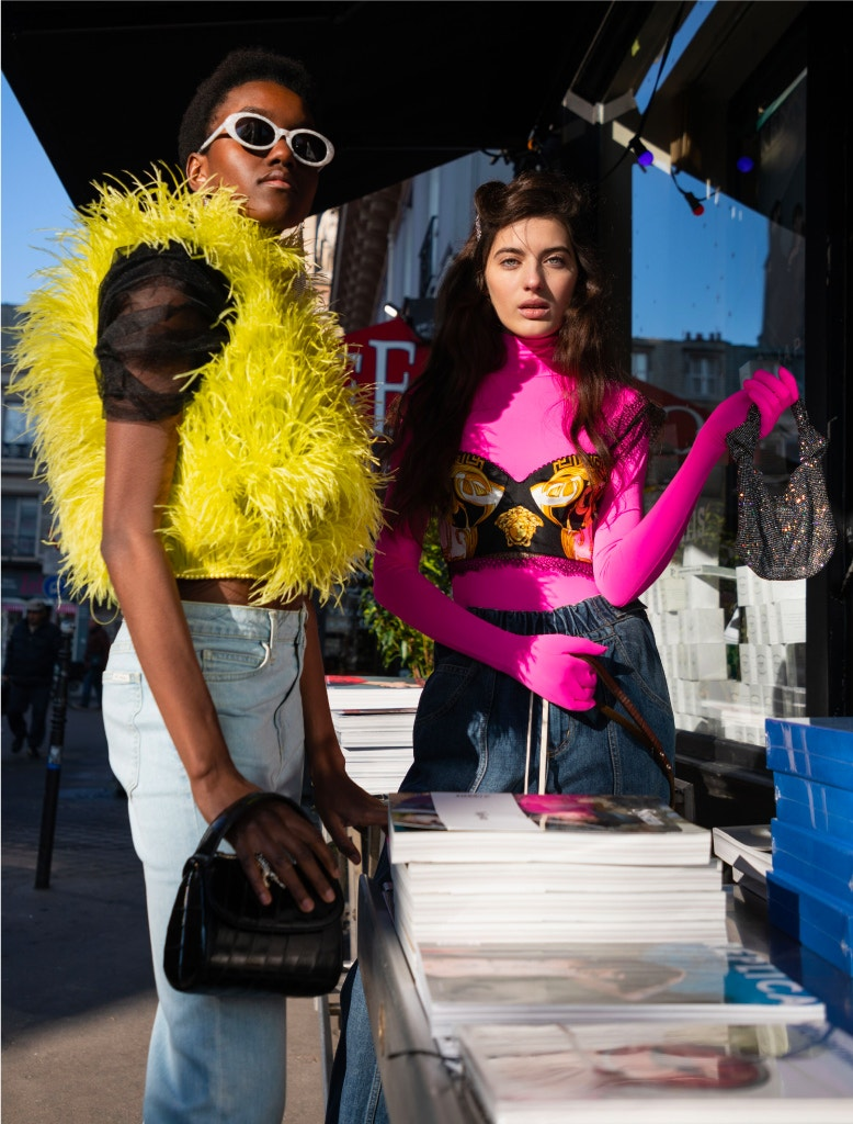 model wearing attico top, eve denim jeans, ysl earrings, roberi & fraud sunglasses, alexander wang mules, amelie pichard bag