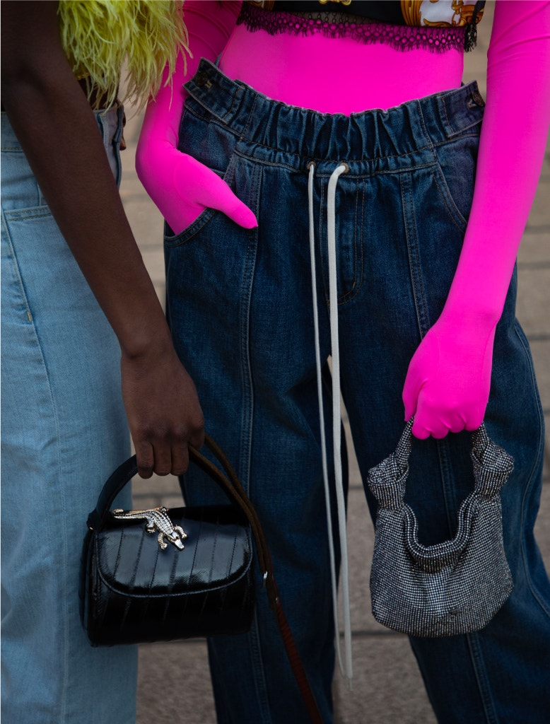 model wearing givenchy joggers amd alexander wang handbag