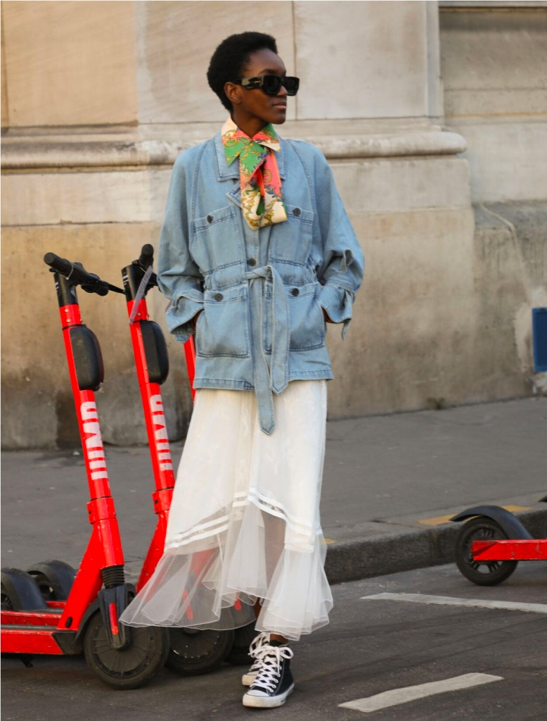 model is wearing mara hoffman denim jacket, gucci blouse, chloe skirt, and gucci sunglasses
