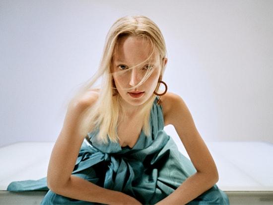 model wearing blue oscar de la renta jumpsuit