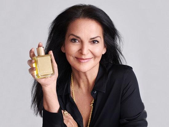 veronique gabai holding her signature perfume