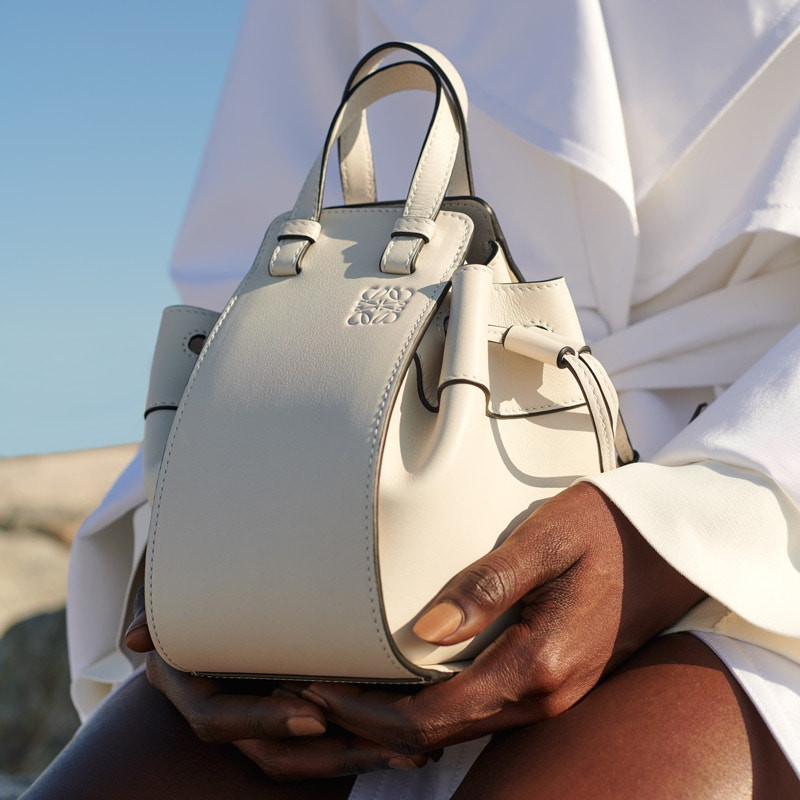 LOEWE Soft White Hammock Drawstring Mini Bag, ADAM LIPPES Trench Coat