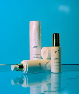 Beauty personal care items, creams, make-up and perfumes are presented on a blue background